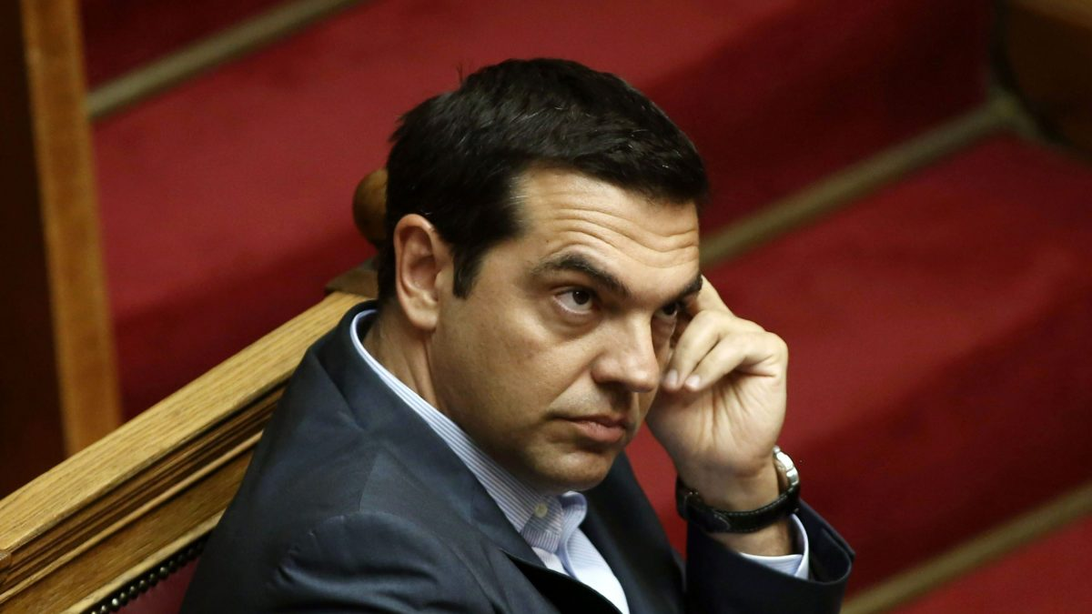 "LKS 20150814 LOU3206; Greek Prime Minister Alexis Tsipras attends an overnight parliamentary debate in Athens on August 14, 2015. A majority of Greek lawmakers on August 14 approved the country's third international bailout after an all-night debate, an AFP count showed. Prime Minister Alexis Tsipras had earlier urged the chamber to approve the deal ""to assure the country's ability to survive and keep on fighting."" LEHTIKUVA / AFP PHOTO / PANAYIOTIS TZAMAROS Instructions: QUALITY REPEAT"