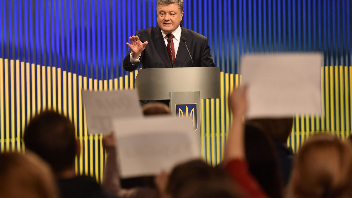 LKS 20160115 SAV265; Ukrainian President Petro Poroshenko gestures during his press conference in Kiev on January 14, 2015 as journalists ask questions. Ukrainian President Petro Poroshenko said he wanted EU and US help in securing Crimea's return from Russian control and vowed to regain sovereignty over the separatist east in 2016. / AFP / GENYA SAVILOV - LEHTIKUVA / AFP