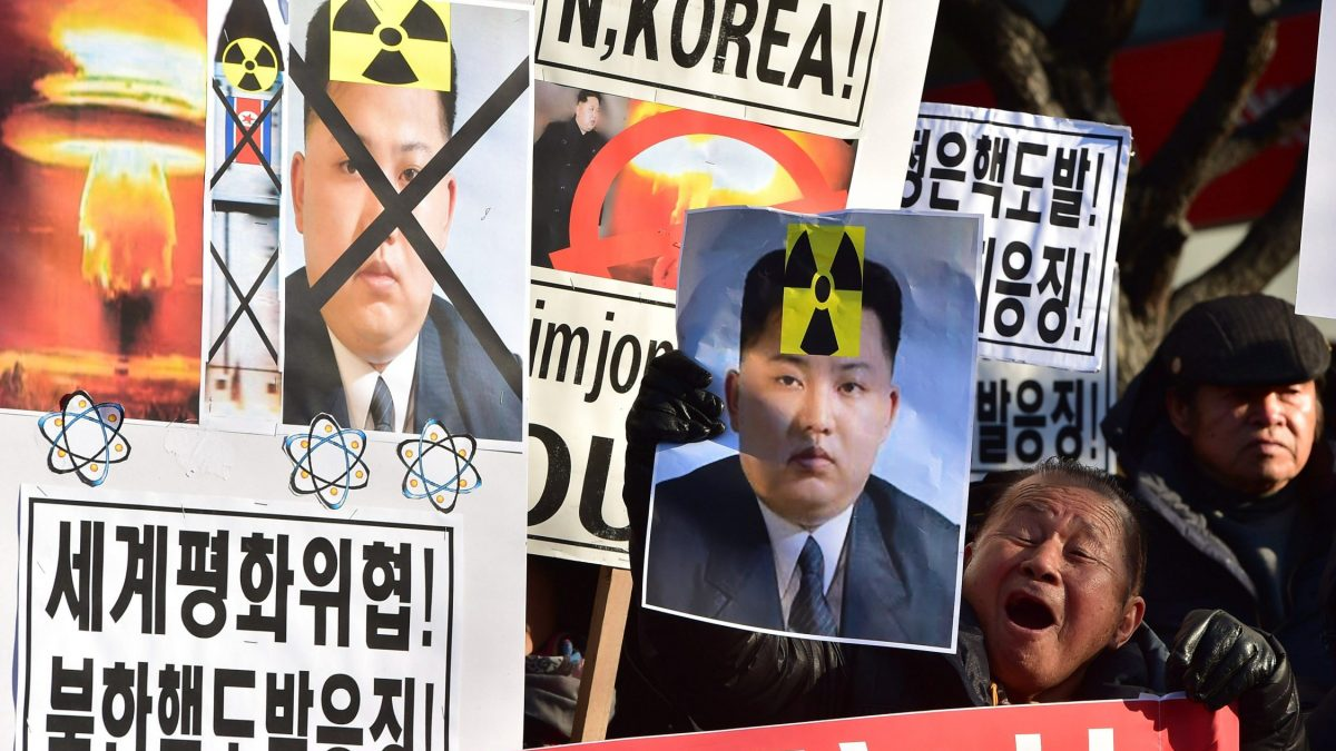 "LKS 20160107 JYJ716; South Korean conservative activists shout slogans with placards showing portraits of North Korean leader Kim Jong-Un during a rally denouncing North Korea's hydrogen bomb test, in Seoul on January 7, 2016. The US and South Korean presidents vowed on January 7 to impose the ""most powerful and comprehensive"" sanctions on North Korea after its globally condemned fourth nuclear test. LEHTIKUVA / AFP PHOTO / JUNG YEON-JE"