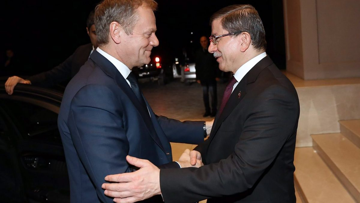 LKS 20160316 190; A handout picture released by the Turkish prime minister's office shows Turkish Prime Minister Ahmet Davutoglu (R) greeting EU Council president Donald Tusk upon his arrival for a meeting at the Cankaya Palace in Ankara on March 15, 2016. EU president Donald Tusk warned that hard work lay ahead to finalise a proposed deal with Turkey to end Europe's migration crisis, after Cyprus threatened to derail it over longstanding disagreements with Ankara. / AFP / PRIME MINISTER'S OFFICE / HAKAN GOKTEPE - LEHTIKUVA / AFP