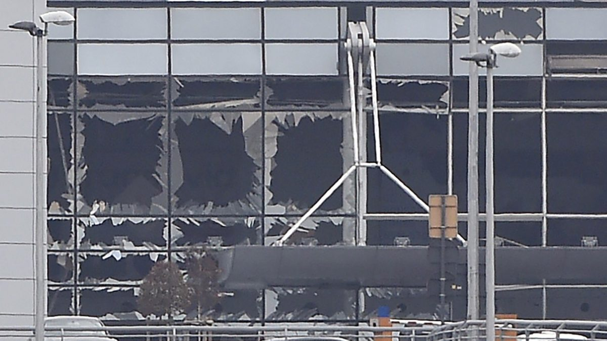 LKS 20160322 019; A picture taken on March 22, 2016 in Zaventem, shows the damaged facade of Brussels airport after at least 13 people were killed and 35 injured as twin blasts rocked the main terminal of Brussels airport. LEHTIKUVA / AFP PHOTO / JOHN THYS