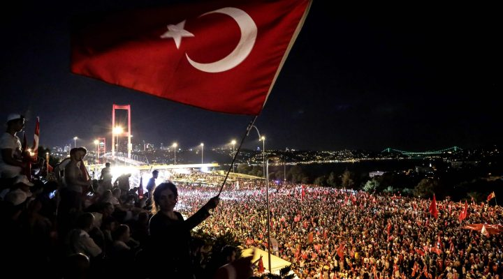 LKS 20160722 7822; Pro Erdogan supporters wave a Turkish national flag during a rally at Bosphorus bridge in Istanbul on July 21, 2016. Thousands of Turkish government supporters on Thursday streamed across one of the two bridges spanning the Bosphorus in Istanbul to protest against the coup that sought to unseat President Recep Tayyip Erdogan one week ago. The Bosphorus Bridge between the Asian and European sides of Istanbul was one of the key battlegrounds in Friday night's coup attempt, as rebel soldiers descended in tanks to block it to traffic and then engaged in battles with opponents. / AFP / UMIT TURHAN COSKUN - LEHTIKUVA / AFP