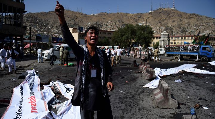 LKS 20160723 WK0021; An Afghan protester screams near the scene of a suicide attack that targeted crowds of minority Shiite Hazaras during a demonstration at the Deh Mazang Circle in Kabul on July 23, 2016. A powerful explosion on July 23, ripped through crowds of minority Shiite Hazaras in Kabul who had gathered to protest over a power line, killing at least 20 people and leaving 160 others wounded, officials said. No group has so far claimed responsibility for the blast, but it comes in the middle of the Taliban's annual summer offensive, which the insurgents are ramping up after a brief lull during the recent holy fasting month of Ramadan. The scene of the blast was littered with charred bodies and dismembered limbs, with ambulances struggling to reach the scene as authorities had overnight blocked key intersections with stacked shipping containers to impede movement of the protesters. / AFP / WAKIL KOHSAR - LEHTIKUVA / AFP