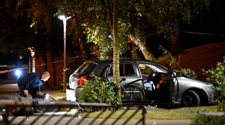 LKS 20160926 dmcf02b; Police technicians examine the car some injured people were travelling in as they investigate the area where at least four people have been injured in a shooting in southern Malmo on September 25, 2016. / AFP / TT NEWS AGENCY / TT News Agency / Emil LANGVAD - LEHTIKUVA / AFP