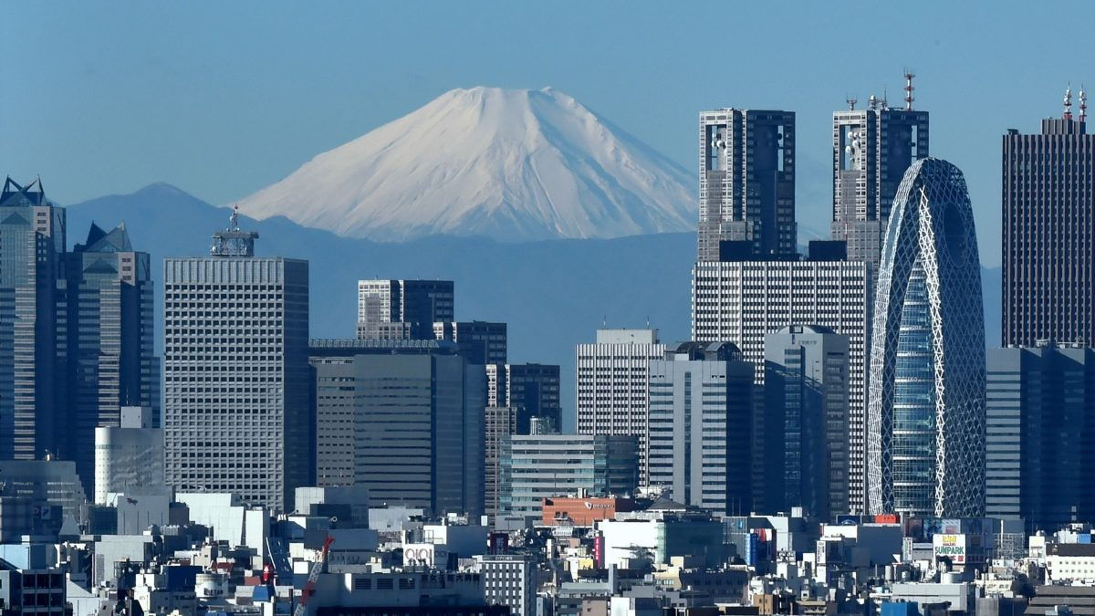 LKS 20161004 - KN050; Embargoed until October 04, 2016 - 13:02:00+00:00 / (FILES) This file photo taken on December 6, 2014 shows Mount Fuji, Japan's highest mountain, seen behind the skyline of the Shinjuku area of Tokyo. The International Monetary Fund on October 4, 2016 lifted its outlook for Japan's economy this year and in 2017, pointing to huge government stimulus spending, but warned that the country's longer-term prospects were bleak. / AFP / KAZUHIRO NOGI - LEHTIKUVA / AFP