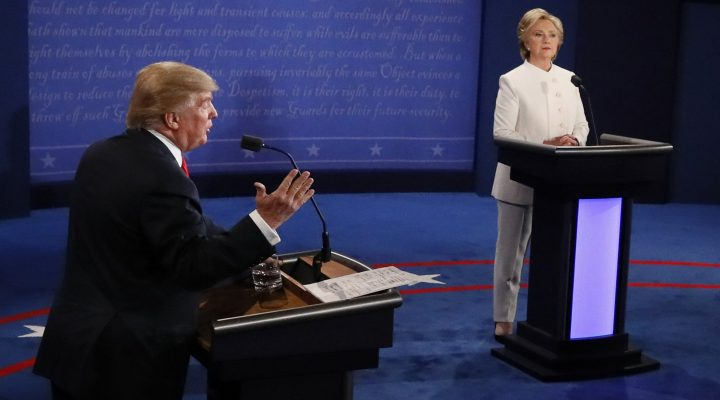 LKS 20161020 Republican nominee Donald Trump (L) gestures as Democratic nominee Hillary Clinton looks on during the final presidential debate at the Thomas & Mack Center on the campus of the University of Las Vegas in Las Vegas, Nevada on October 19, 2016. / AFP / Mark  RALSTON - LEHTIKUVA / AFP